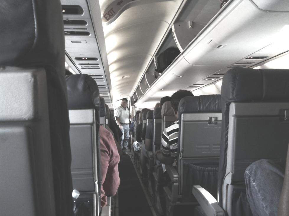 boarding-airplane-aisle-640x480